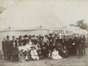 Simpson and others in front of a tent used for meetings.