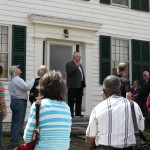 Elder James R. Nix speaking about William Miller to a group touring Miller's home.